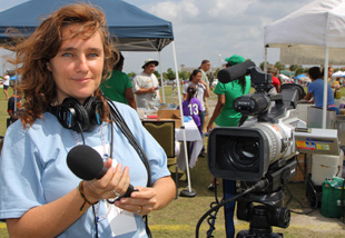 Woman Operating Camera at Sporting Event